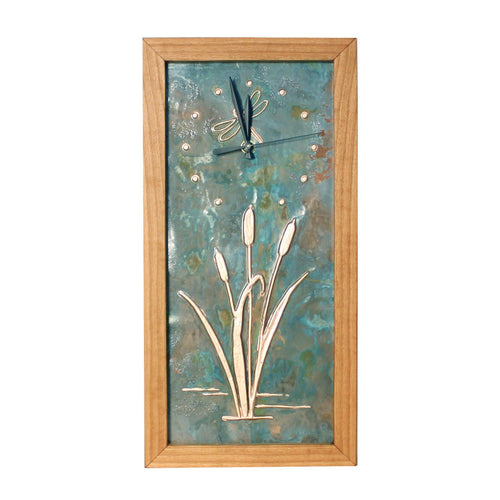 Vertical rectangular cherry wood and patina copper clock with cattail and dragonfly copper design.