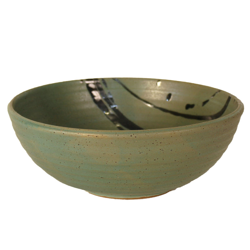 Large dark green serving bowl with black accent lines across corner.