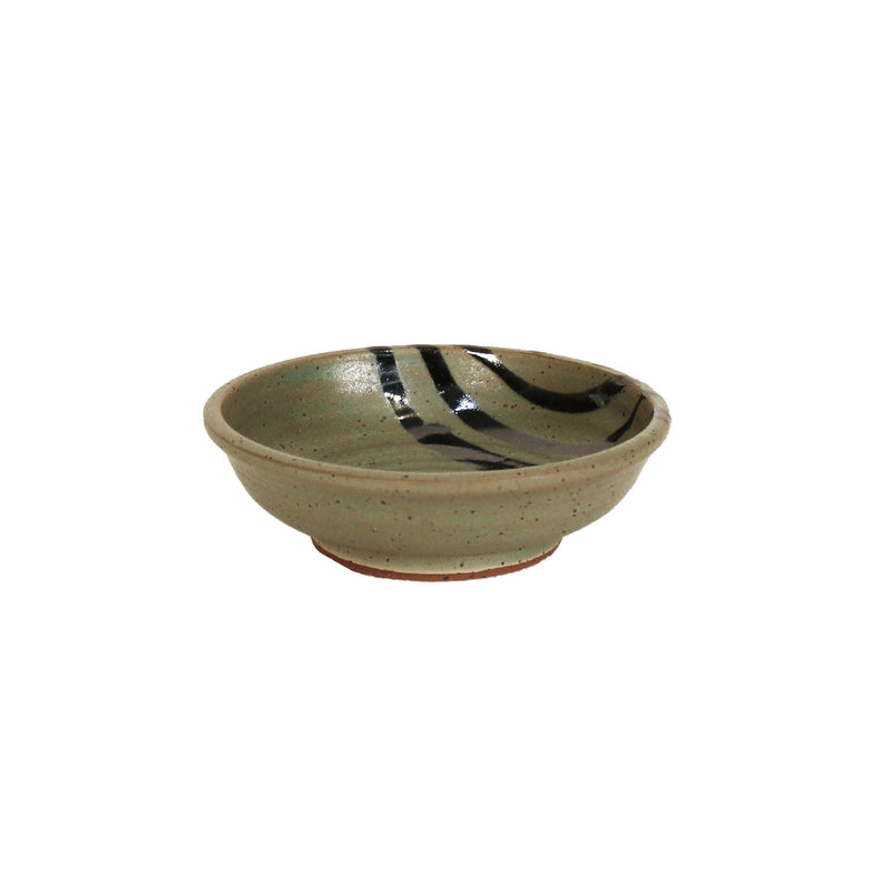 Small sage green bowl with black accent lines across corner.
