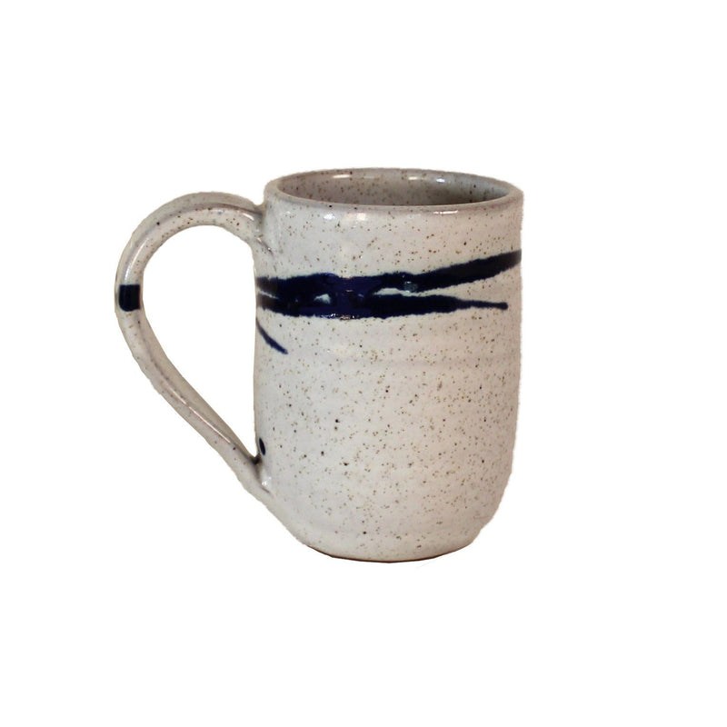 White mug with cobalt blue accent lines around top near rim.