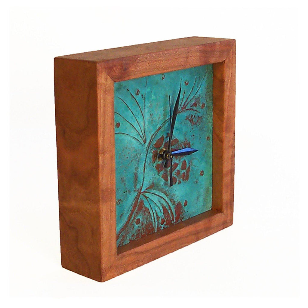 Square clock framed with cherry wood and patina copper face with pine cone and branch design