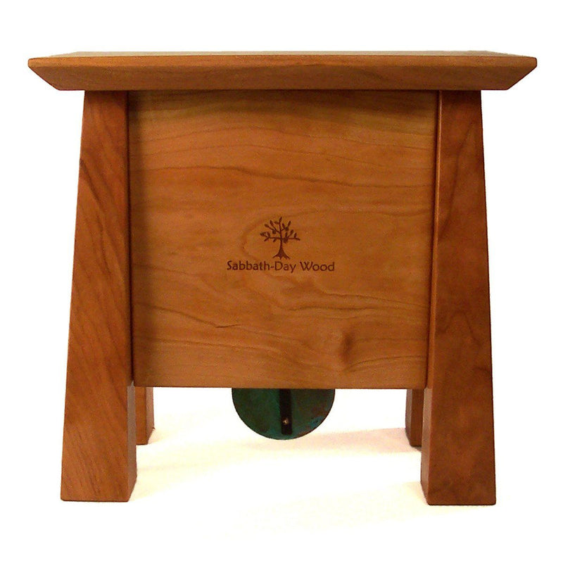 Back view: Cherry wood clock with 4 tapered legs, centered Sabbath-Day Woods logo.