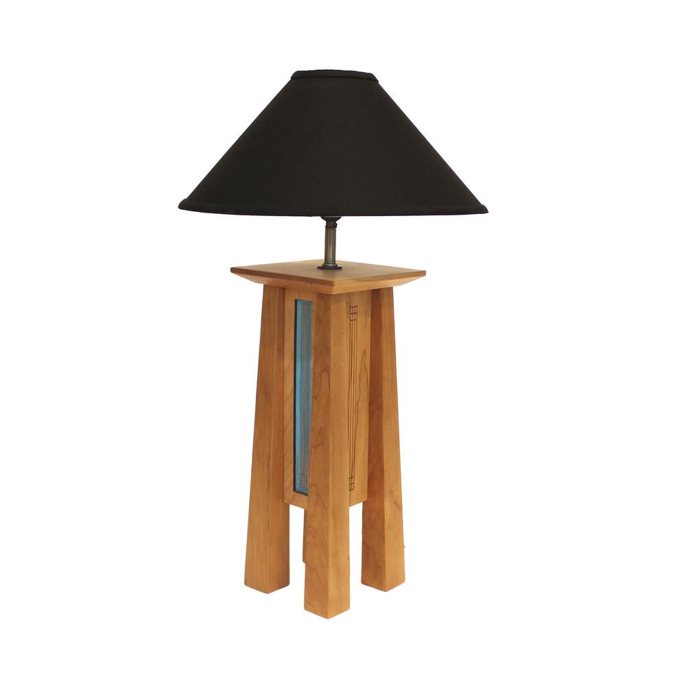 Tall 4-legged cherry wood lamp base with patina copper sides and black linen lamp shade.