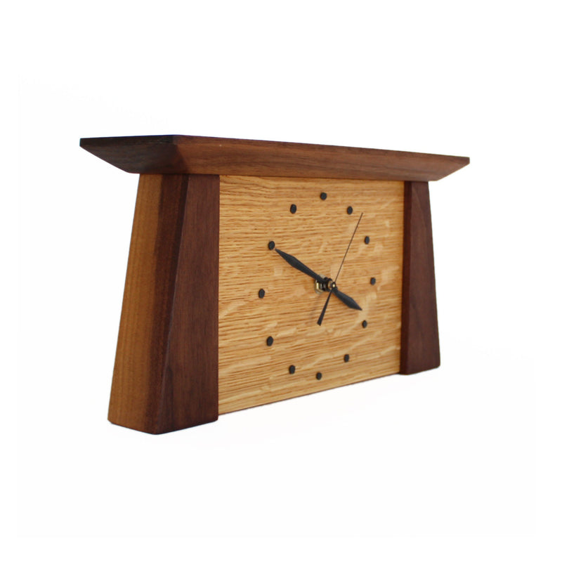 Side view: tapered rectangular walnut wood framed oak wood clock.