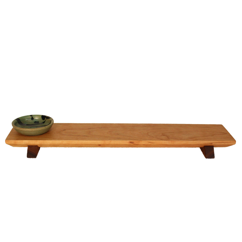 Long cherry wood (walnut wood feet) sushi tray with dark green and blue sauce bowl.