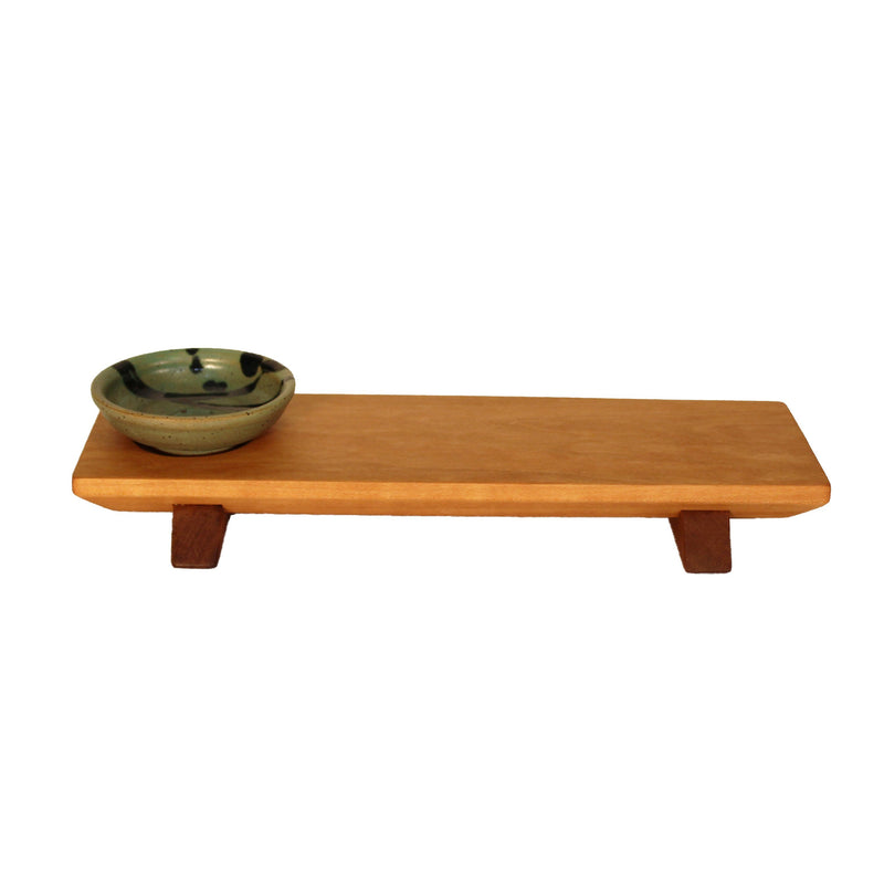 Short cherry wood (walnut wood feet) sushi tray with dark green and blue sauce bowl.