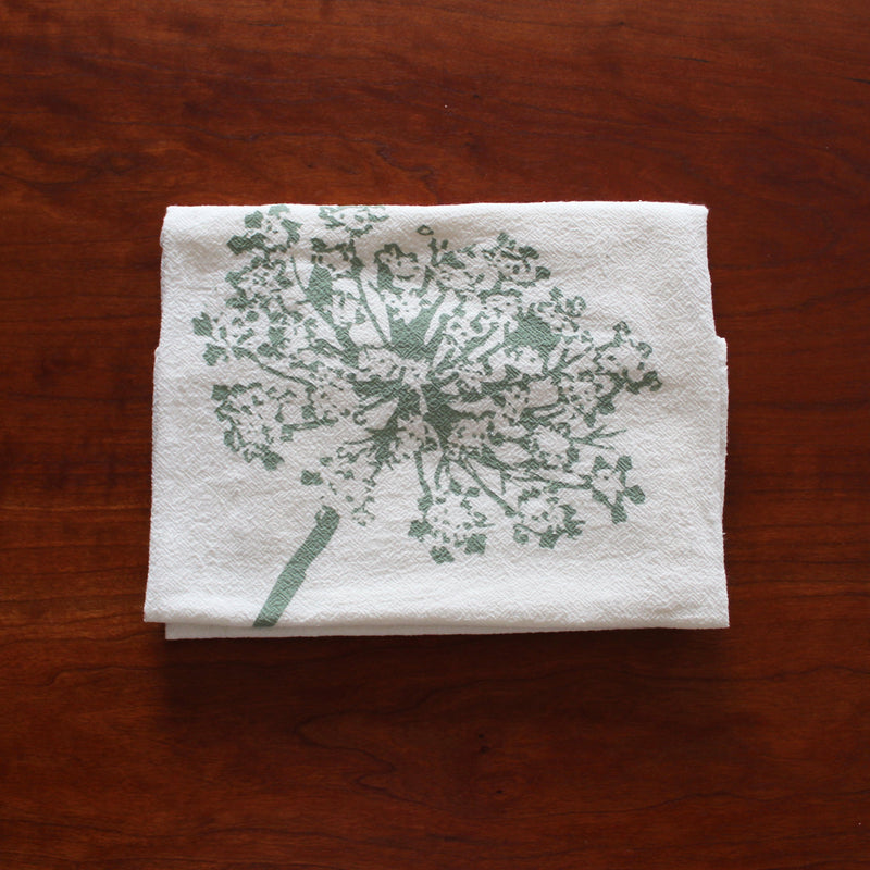 Folded white flour sack cotton kitchen towel with Queen Anne's Lace printed graphic