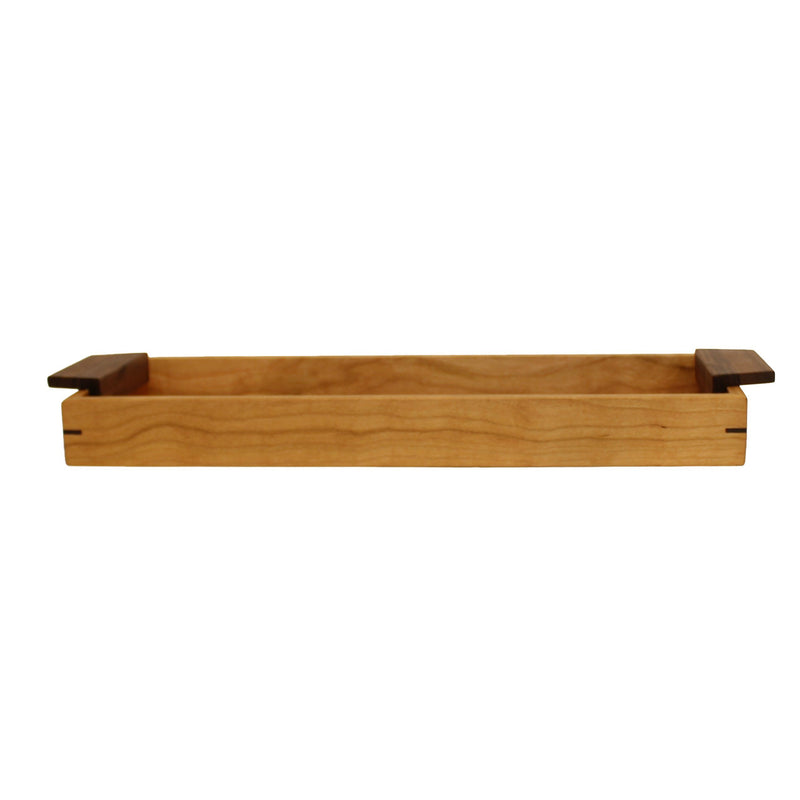 "Narrow rectangular cherry wood tray with 1.75"" sides and walnut handles on both ends."