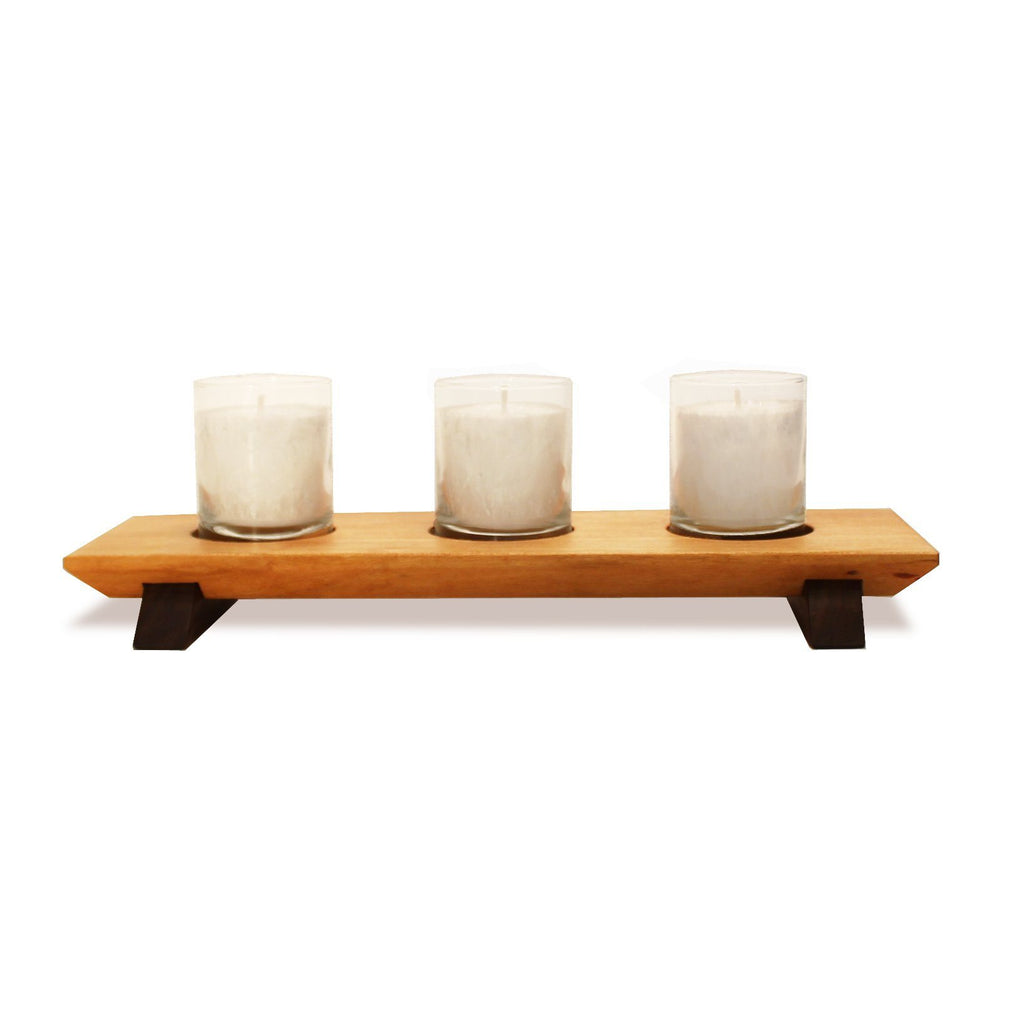 Cherry wood 3-votive holder with walnut wood feet. 3 white textured wax votive candles.
