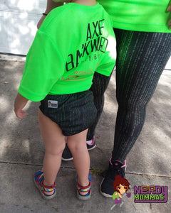 Mother wearing leggings that match the cloth diaper being worn by her child.
