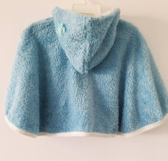 Light blue hooded winter cape