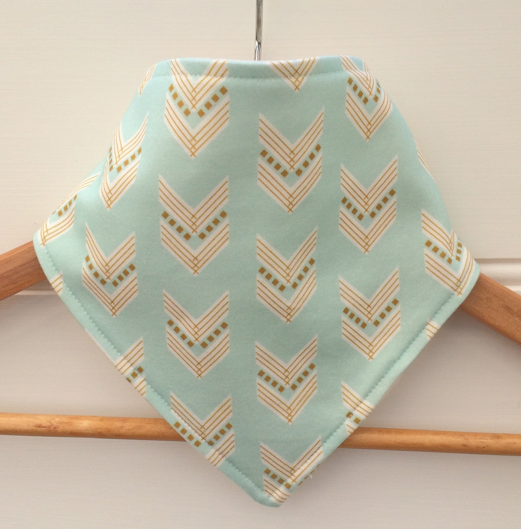 Organic Bandana Bib in Blue & Gold Arrows