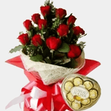 Bouquet of twelve red roses with chocolate