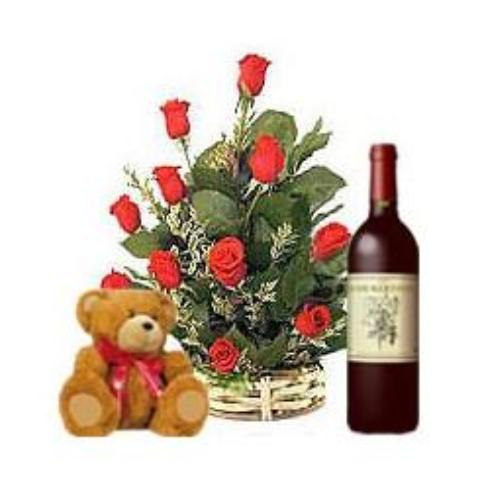 Basket of twelve red roses with wine and bear
