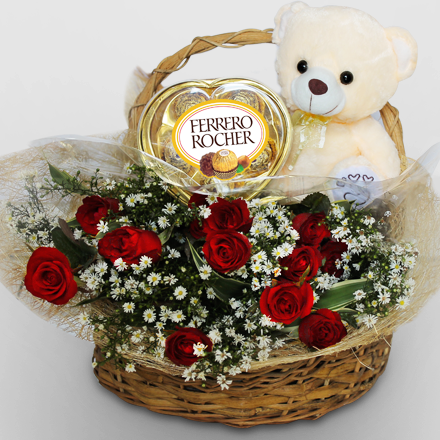 Basket of twelve roses, chocolate, and bear