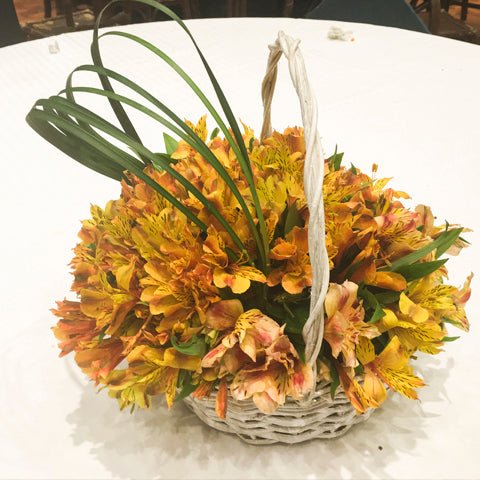 Alstroemeria in a basket (gold and white)
