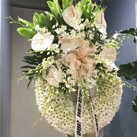 Circular wreath radost with white anthuriums and white orchids
