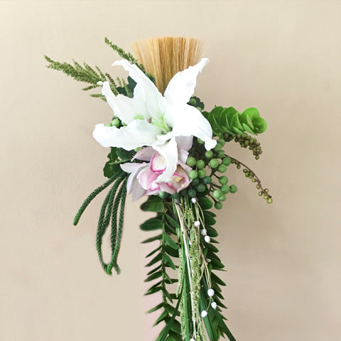 White casa blanca, and light pink cymbidium with berries