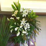 Calla lilies, casa blanca lilies, gold or green berries and orchids, with rattle snakes