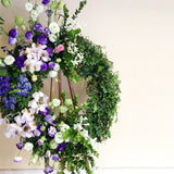 Green wreath with purple roses