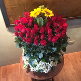 Basket of 3 Sunflowers and 48 pcs of red roses with alstroemeria