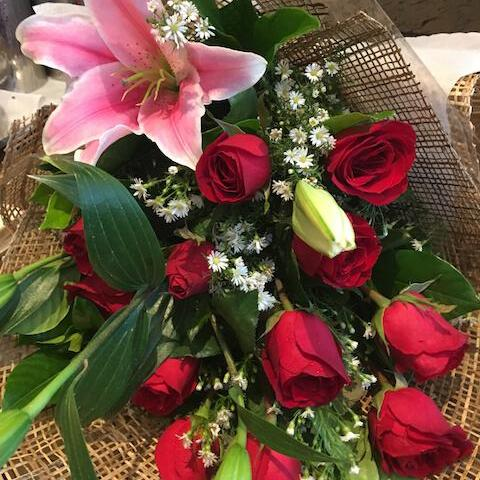 Bouquet of 12 Red Roses with Stargazer