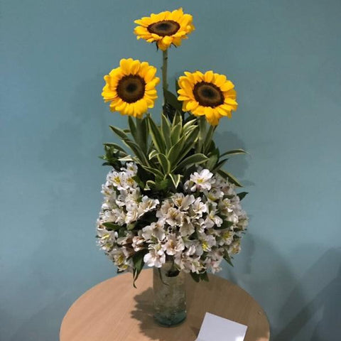 Vase of three sunflowers