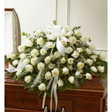 White roses in a casket