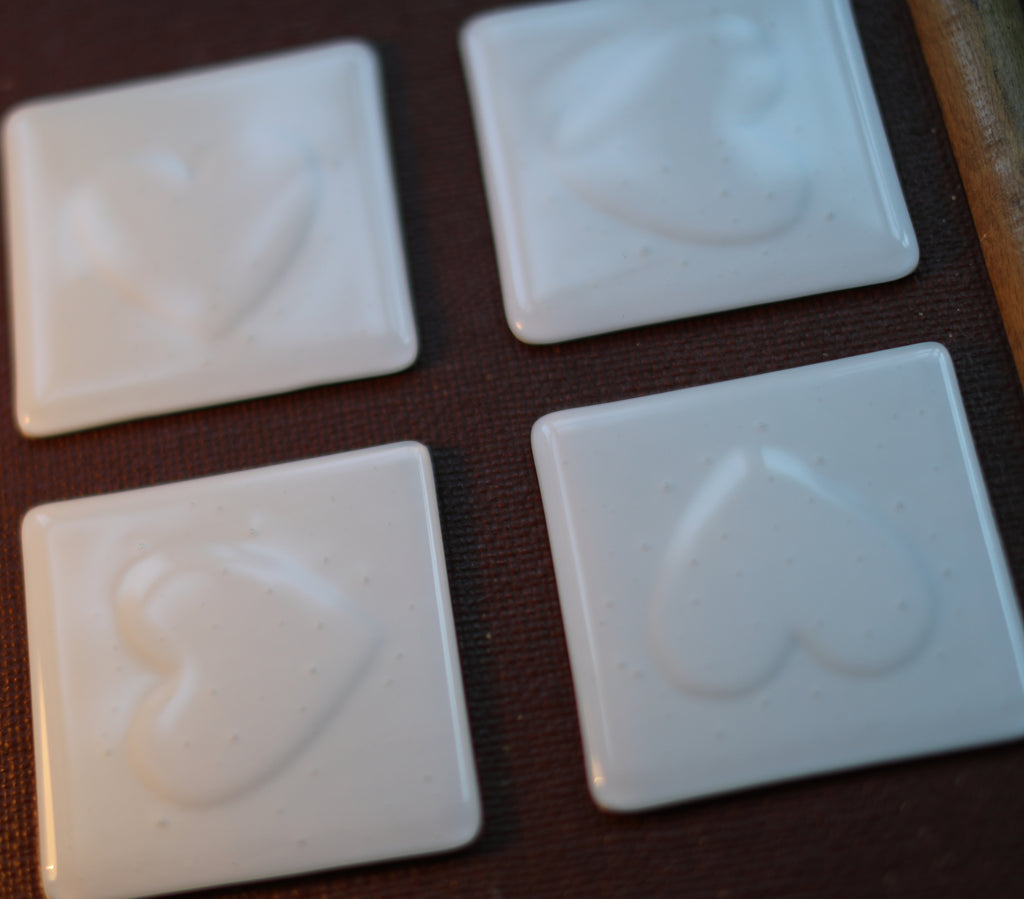 Heart impression design white fused art glass coaster 100x100mm size on packing trunk