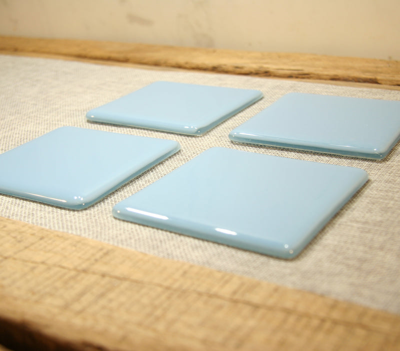 Powder blue opal fused art glass coaster 100x100mm size angled view