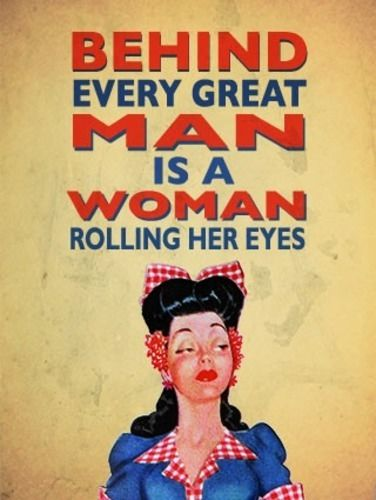 Behind every great man is a woman rolling her saying.  Fridge Magnet