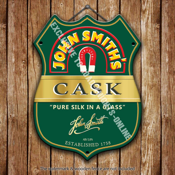 john-smiths-cask-beer-advertising-bar-old-pub-drink-pump-badge-brewery-cask-keg-draught-real-ale-pint-alcohol-hops-shield-shape-metal-steel-wall-sign