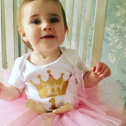 Princess Crown in old gold on a baby vest