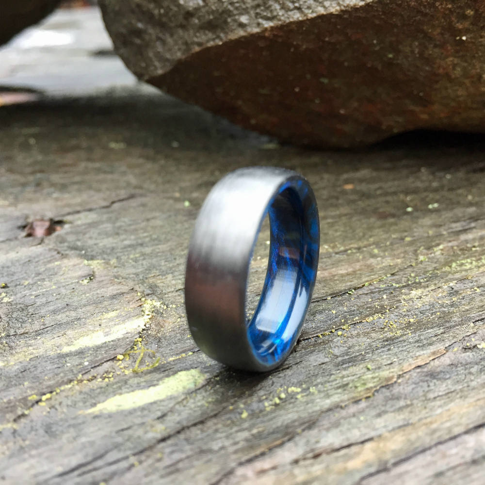 CARBON FIBER WEDDING RING WITH A BLUE & BLACK RESIN INTERIOR