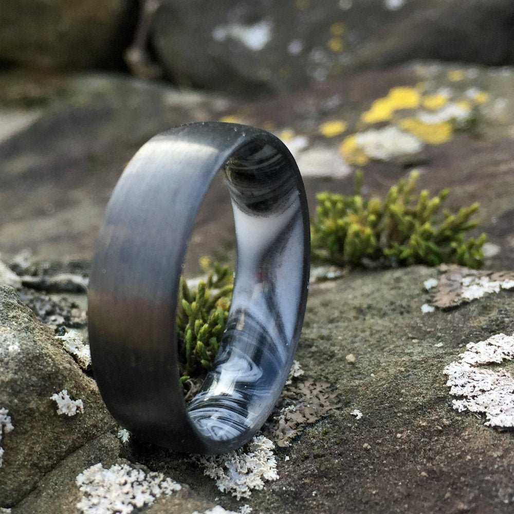 CARBON FIBER WEDDING RING WITH A MARBLED RESIN INTERIOR