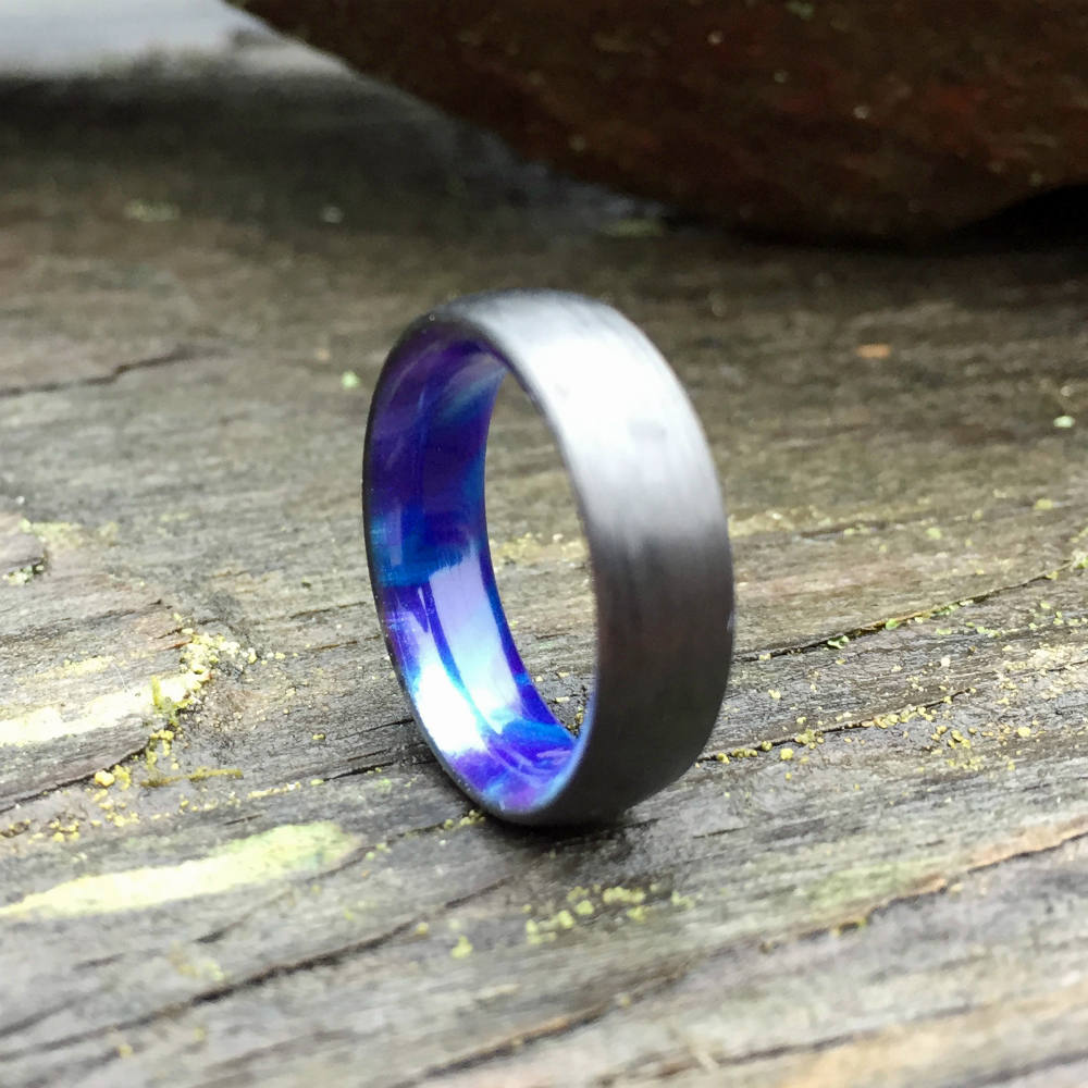 CARBON FIBER WEDDING RING FEATURING A BLUE & PURPLE RESIN INTERIOR