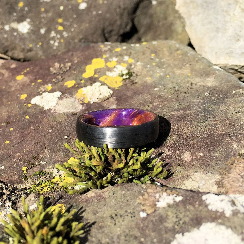 CARBON FIBER WEDDING RING WITH AN ORANGE & PURPLE RESIN INTERIOR