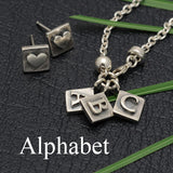 Solid silver designer alphabet mix & match charms by Annika Rutlin