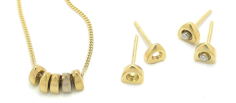 Idun 18 carat gold diamond necklace and earrings by Annika Rutlin