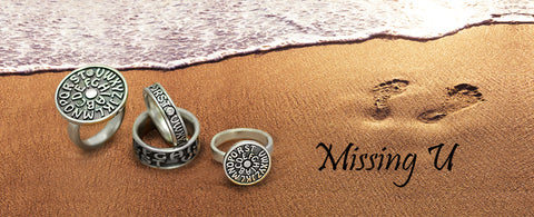 missing you rings in sand beach image annika rutlin silver designer jewellery