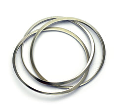 Large interlocking bangles United collection Annika Rutlin