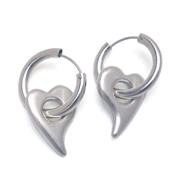 solid silver romantic soft heart earrings on sleeper hoops by Annika Rutlin