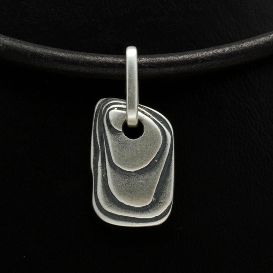raw layered textured solid silver rectangular pendant by Annika Rutlin