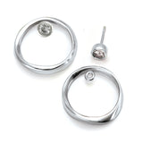 seperate white sapphire 4mm stud and silver circle jacket by Annika Rutlin