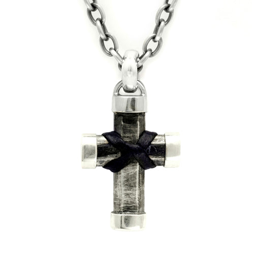 Unusual chunky solid silver cross featuring ossell knot in leather on trace chain