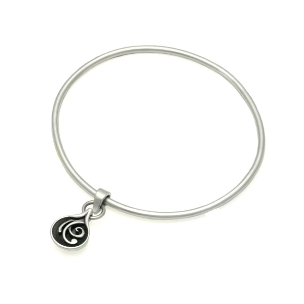 Reversible solid silver swirl patterned or plain droplet bangle