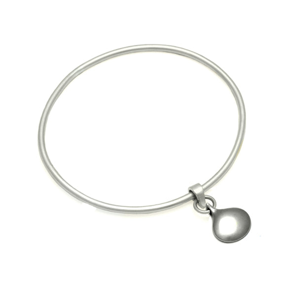 Reversible solid silver patterned or plain droplet bangle by Annika Rutlin