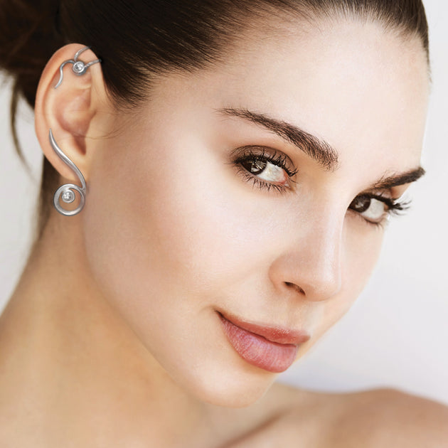 Annika Rutlin jewellery white gemstone silver earclimbers on model