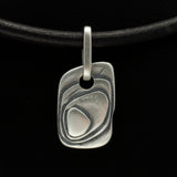 alternative dog tag jewellery with layered texture made from solid silver on leather