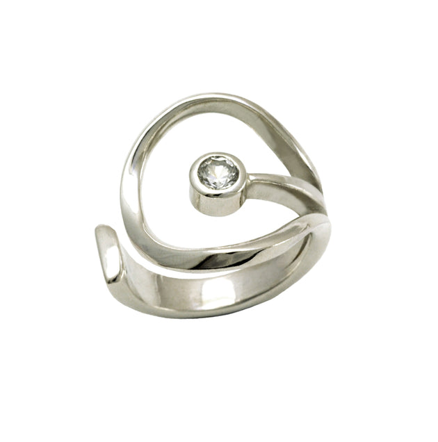 silver circle ring with central sapphire by award winning designer Annika Rutlin